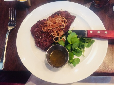 Skirt Steak with Crispy Shallots, Rocket and Green Peppercorn Sauce